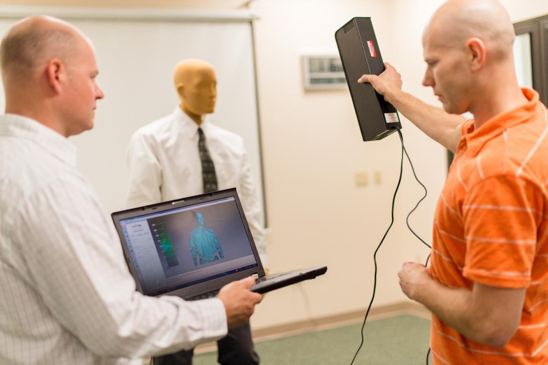 ThermoAnalytics engineers performing human thermal comfort testing with a manikin