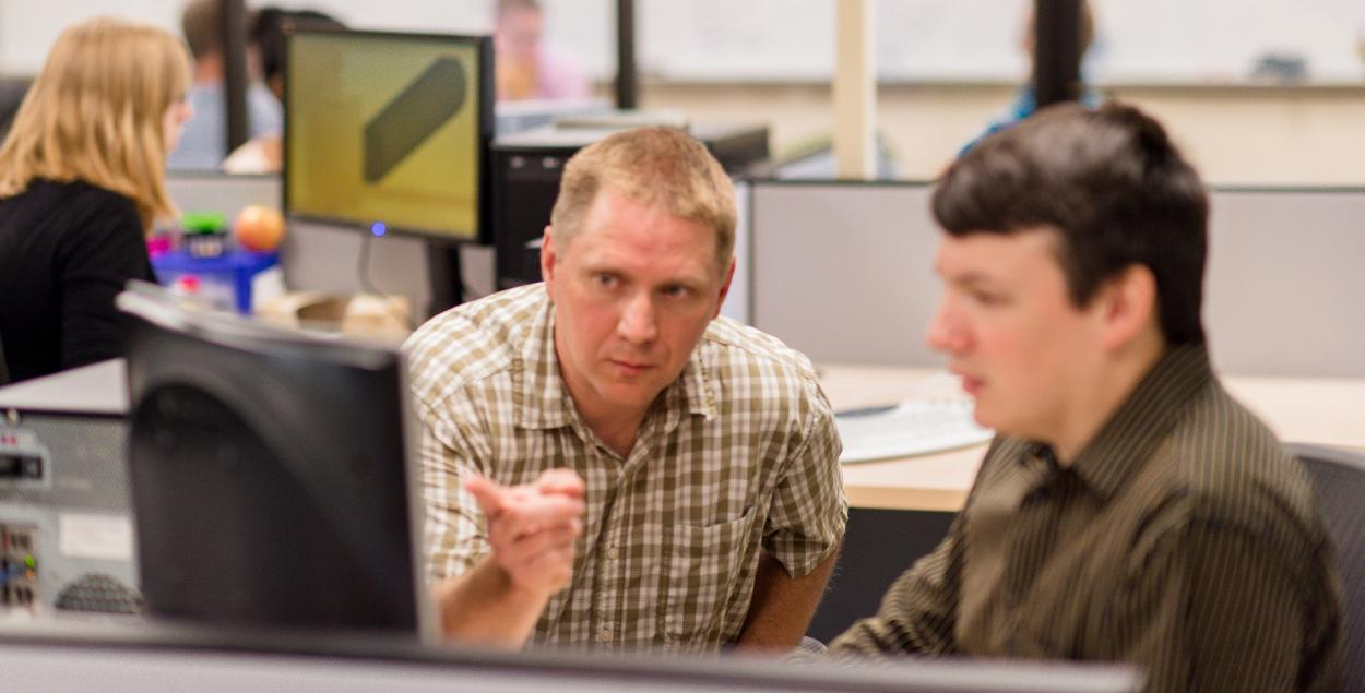 two ThermoAnalytics software developers discussing the code