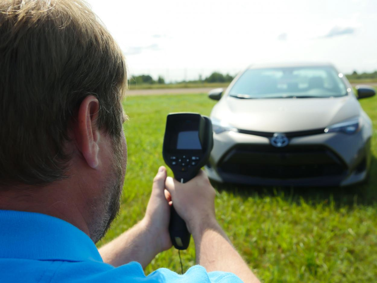 thermal engineer point a flir infrared camera at toyota camary hood for field test